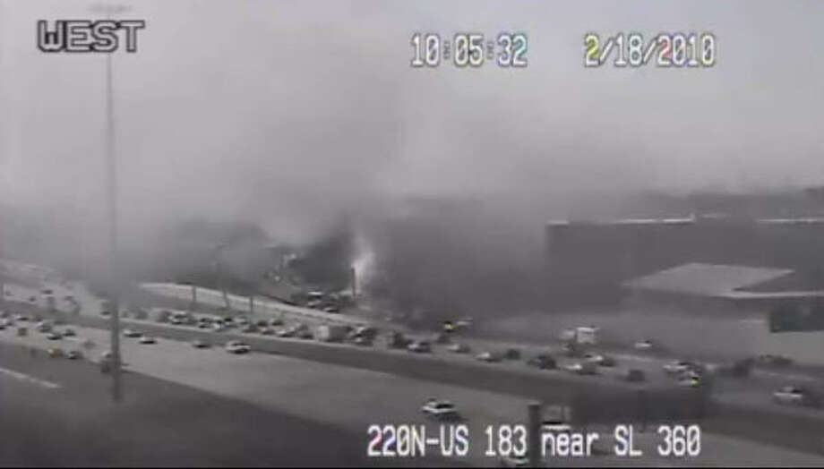 An image from a live camera of the plane crash. Photo: KVUE/KHOU