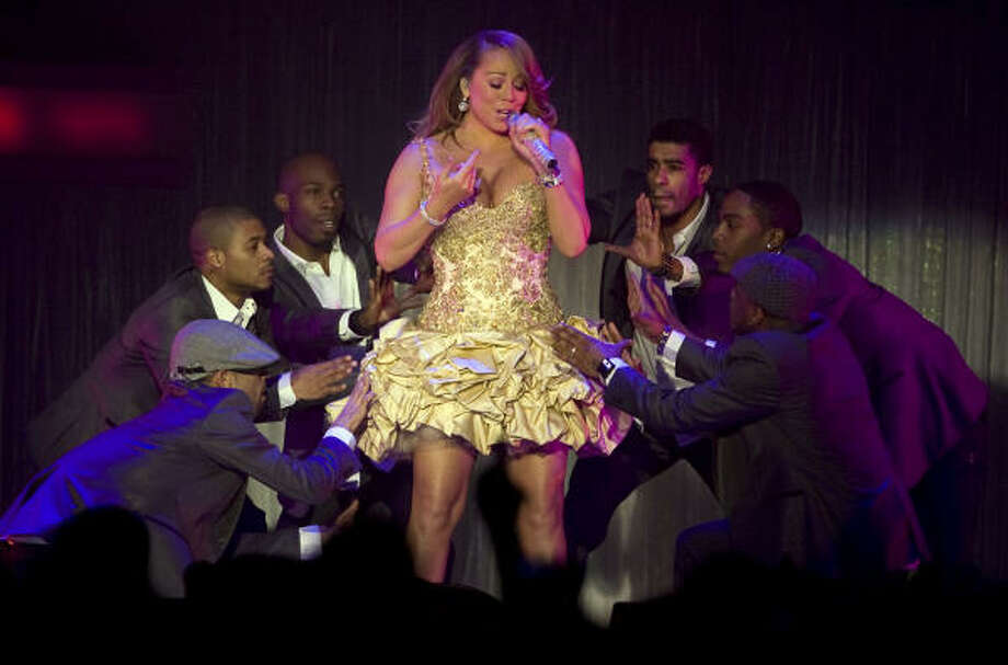 Pop star Mariah Carey came to Houston on Wednesday for a performance at the Verizon Wireless Theater. She was joined by dancers during her concert. Photo: JAMES NIELSEN, CHRONICLE