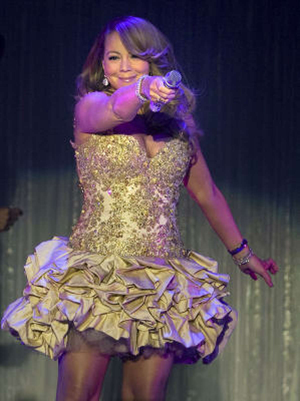 Mariah Carey gives the Houstonians a chance to sing.