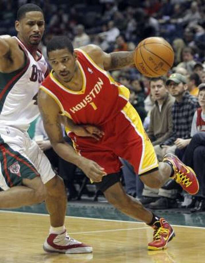 Trevor Ariza, right, scored 22 points to lead seven Rockets in double-figures. Photo: Darren Hauck, AP