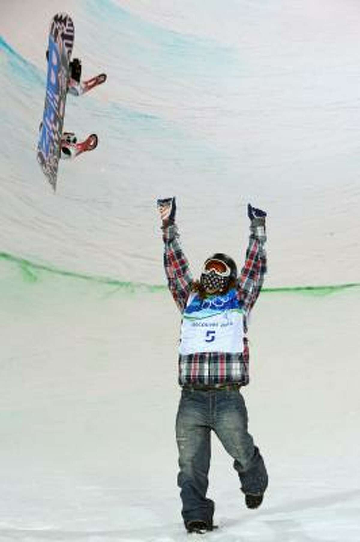 U.S. gold medalist Shaun White celebrates after the men's snowboard halfpipe final run.