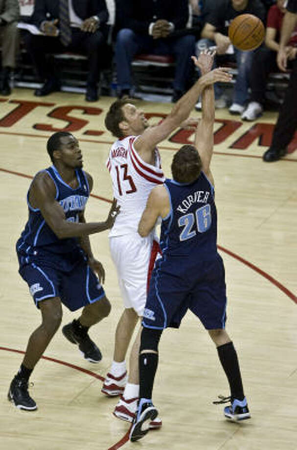 Rockets backup center David Andersen sank two 3-pointers a minute apart to give the Rockets a 93-90 lead late in the fourth quarter. Andersen finished with 18 points in the 104-95 loss to Utah. Photo: James Nielsen, Chronicle