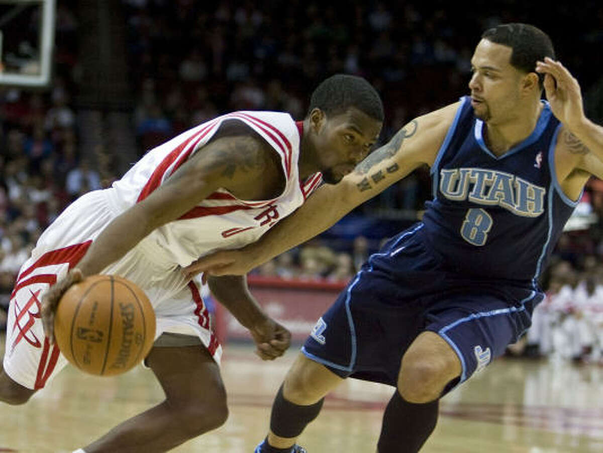 Rockets guard Aaron Brooks, left, had only three of his 18 points in the second half.