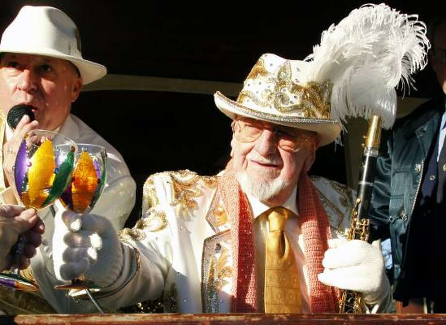 Pete Fountain gives a toast as he leads his Half Fast Walking Club through the streets of New Orleans, Tuesday.  This is the 50th year Fountain has led his group celebrating the all day street party of Mardi Gras. Photo: Bill Haber, AP
