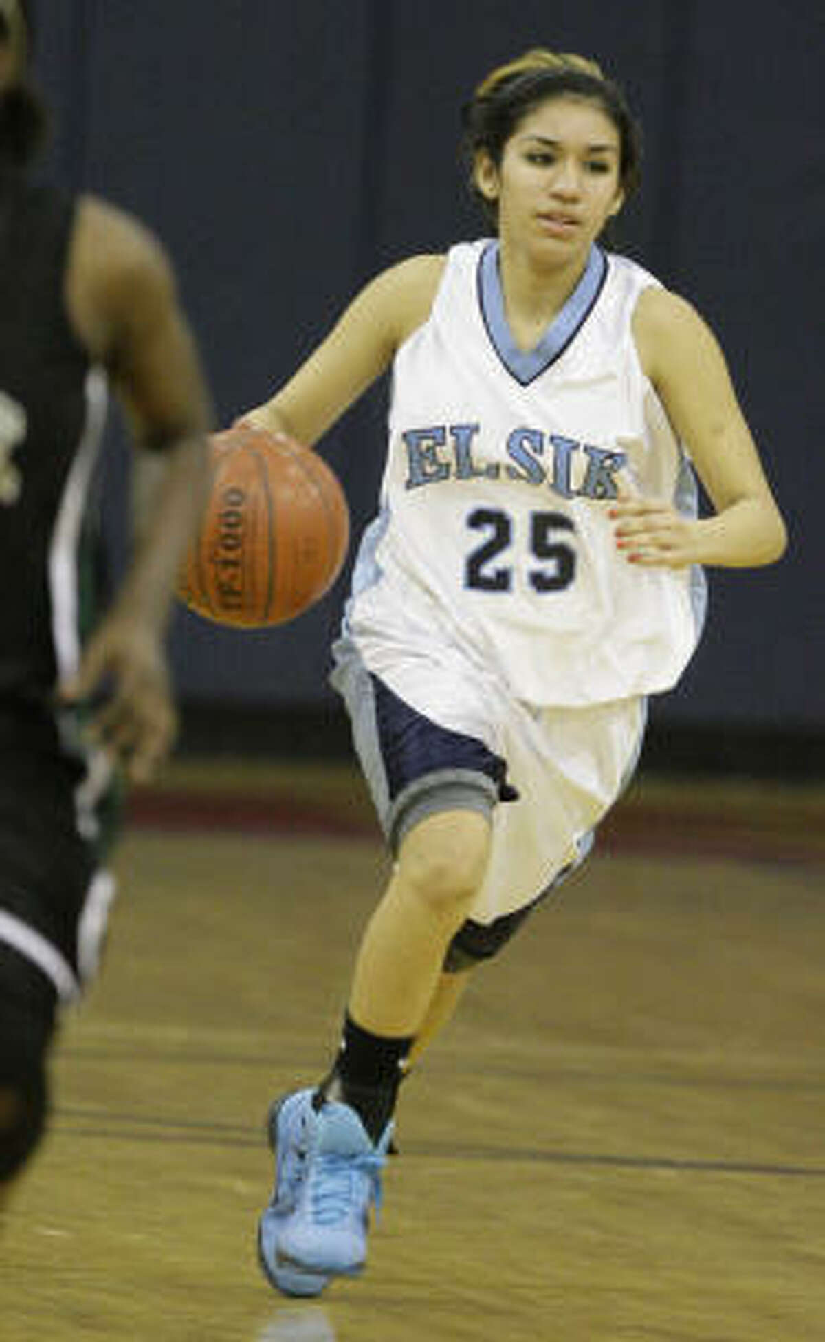 Elsik's Jazmine Ocanas dribbles up court in a Feb. 16 Class 5A bi-district game against Mayde Creek. Elsik won 91-44 to advance to the area round.