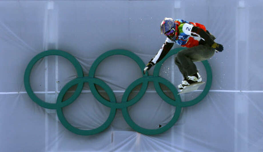 Lindsey Jacobellis comes in for a landing on the final jump in the women's snowboard cross. Photo: Paul Chinn, Chronicle