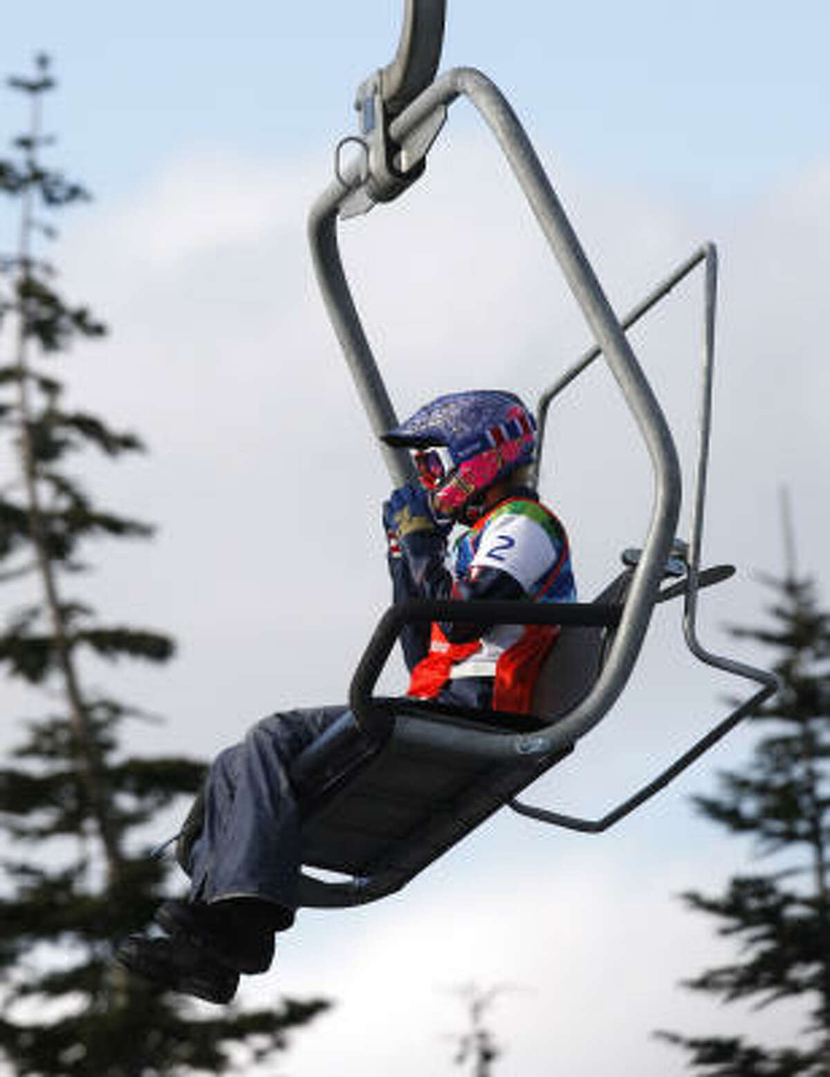 After losing out on a chance to race for a medal, Lindsey Jacobellis rides the chair lift up to the top to compete in the consolation race.
