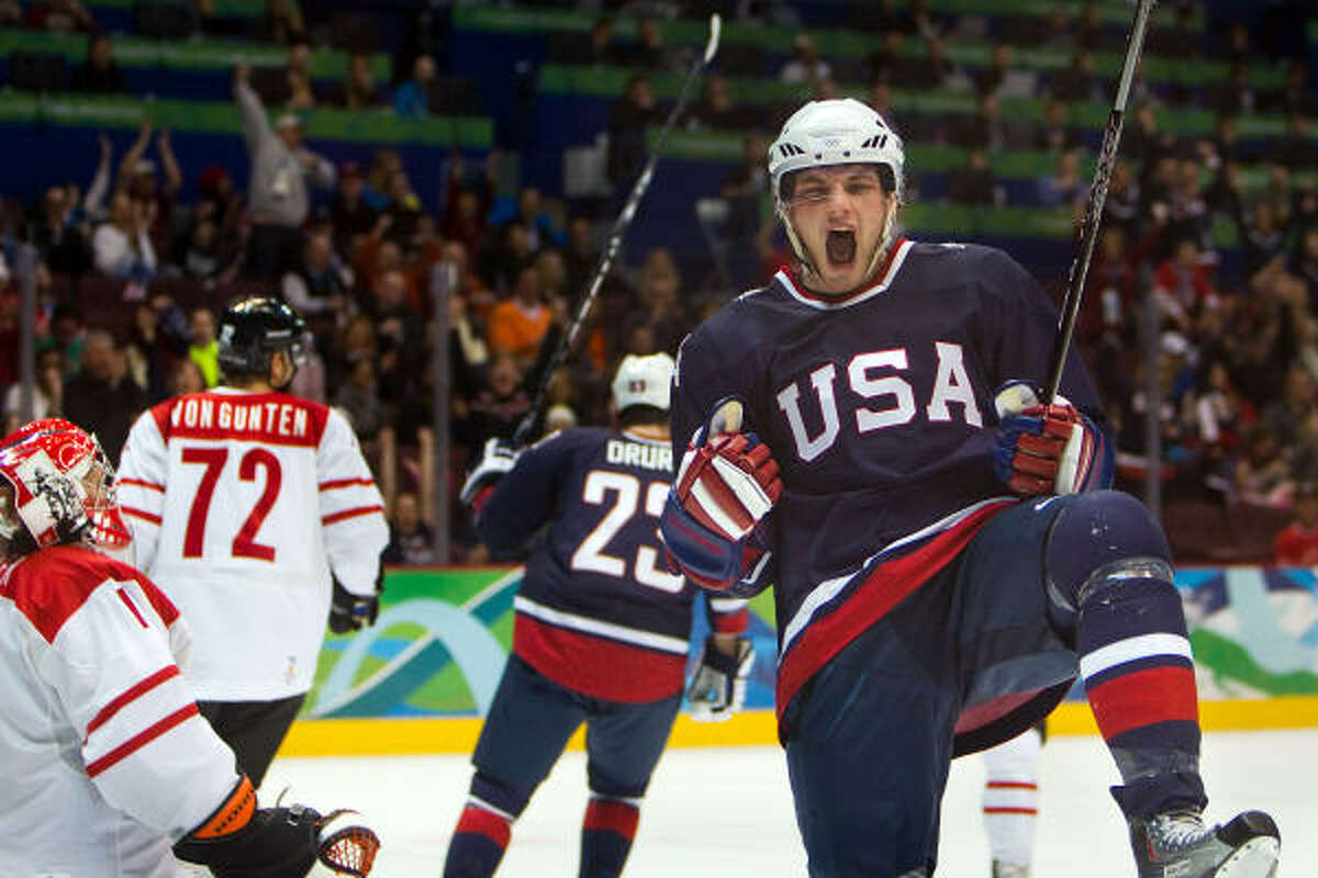 The United States' Bobby Ryan celebrates after scoring past Switzerland goalie Jonas Hiller for the first goal of the tournament in the first period Feb. 16. The U.S. won 3-1.