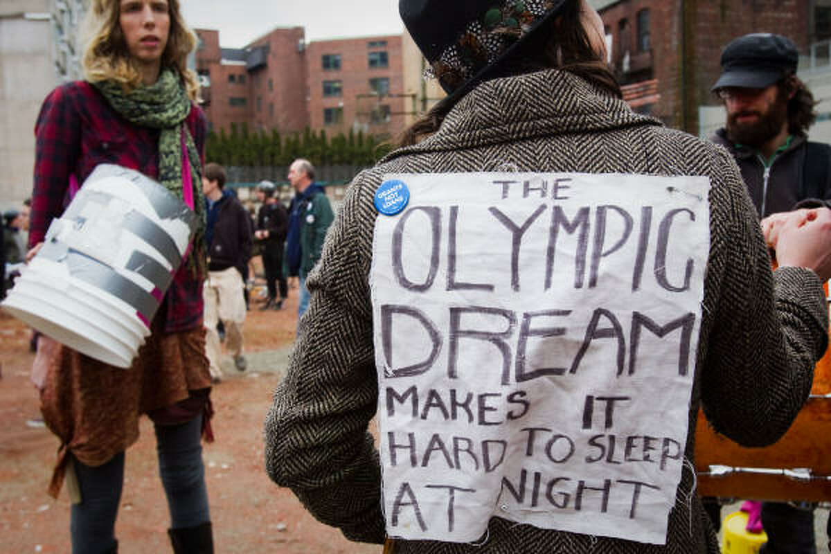 Protesters gather to demonstrate against the Olympic Games and in favor of housing for the homeless.