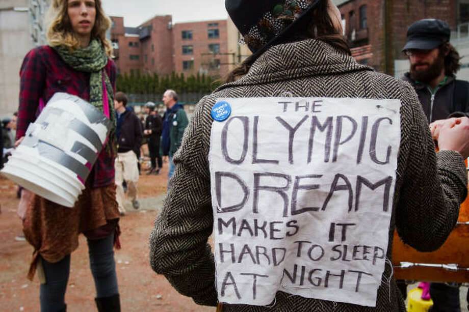 Protesters gather to demonstrate against the Olympic Games and in favor of housing for the homeless. Photo: Smiley N. Pool, Chronicle Olympic Bureau