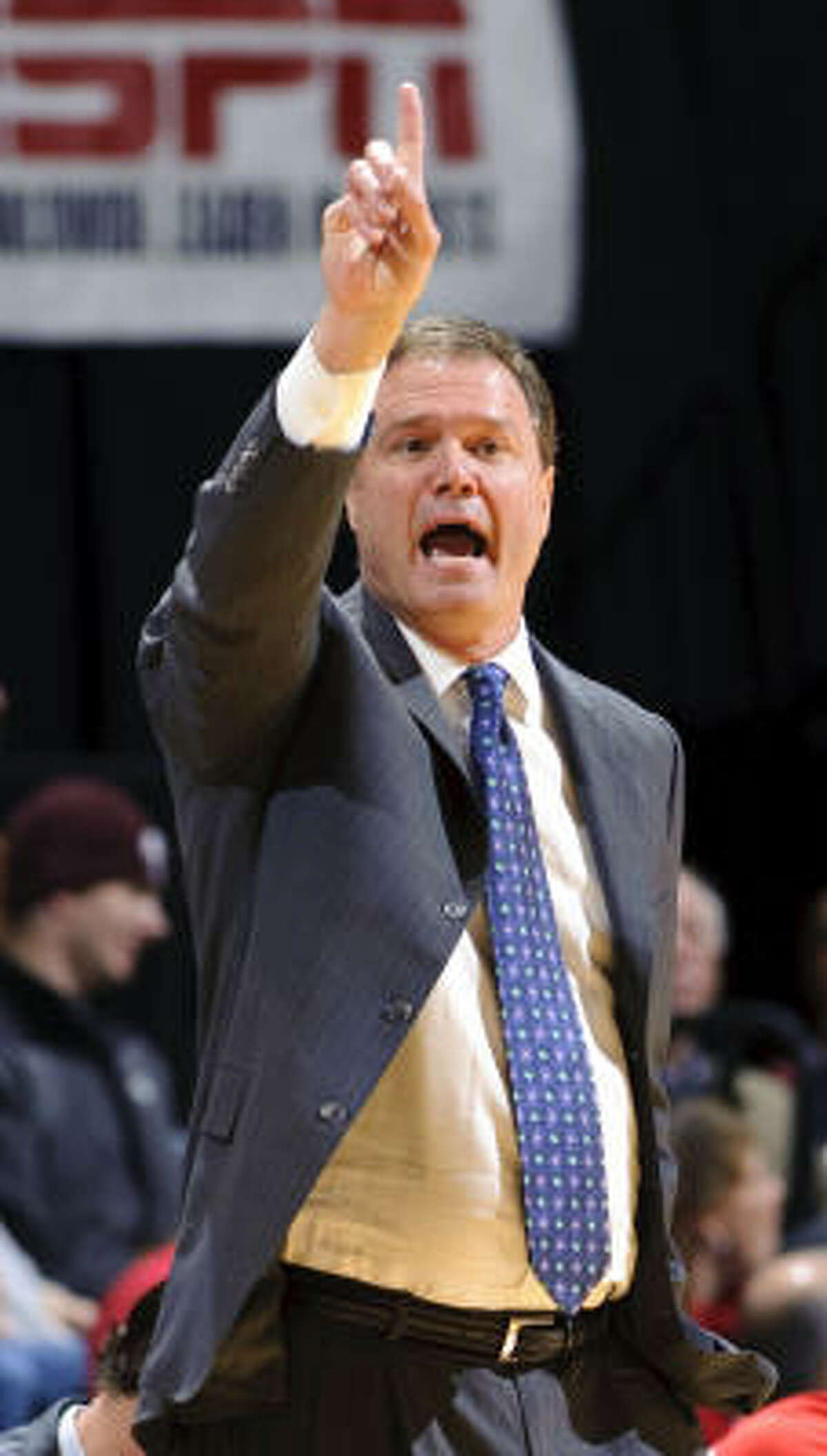 Kansas head coach Bill Self directs his team during the first half, during which his team was outscored 32-20 by Texas A&M.