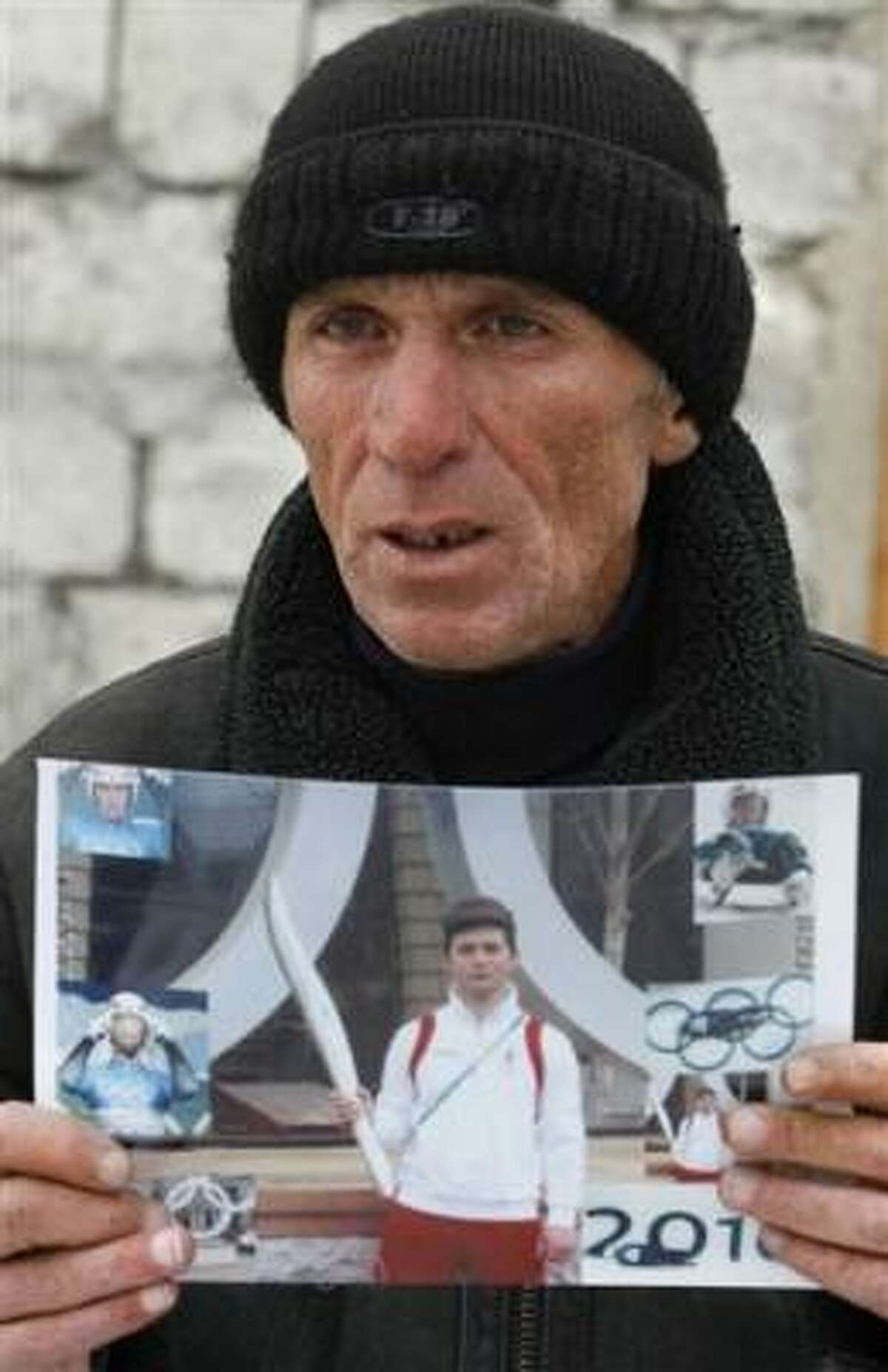 David Kumaritashvili, father of Nodar Kumaritashvili, the Georgian luger killed on an Olympic training run, shows a photo his son e-mailed from Vancouver, British Columbia. The 21-year-old luger died during Friday practice when he lost control of his sled and slammed into a trackside pole.