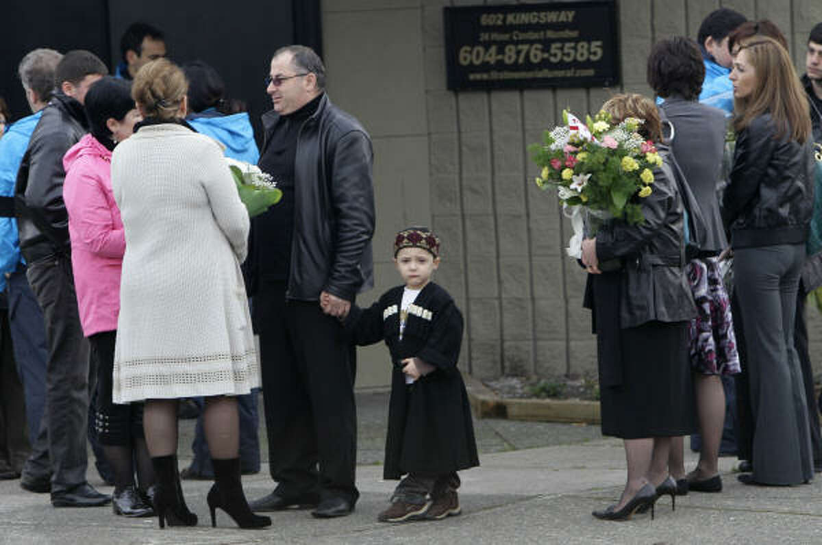 Mourners gather Monday while awaiting the start of a memorial service in Vancouver, British Columbia, for luge athlete Nodar Kumaritashvili of Georgia.