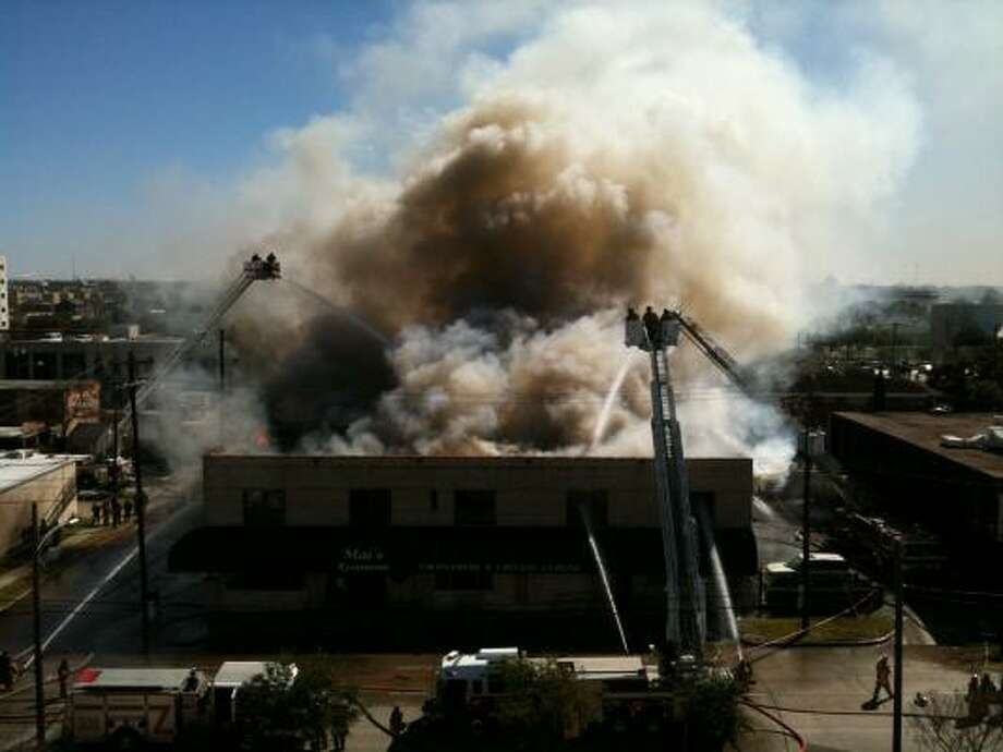 Houston firefighters battle a blaze that engulfed a popular Vietnamese and Chinese restaurant in Midtown. Photo: Michael Paulsen