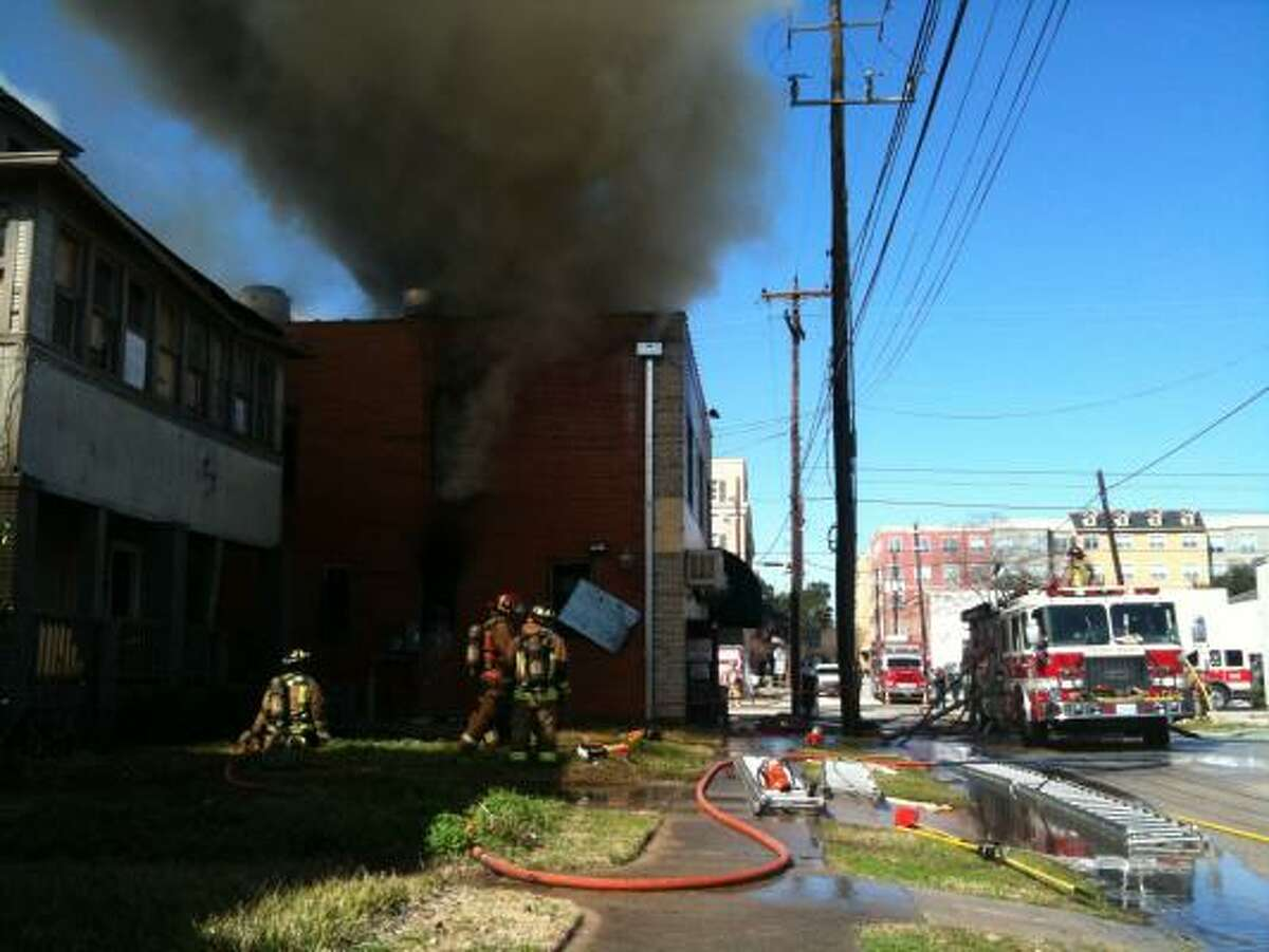 Heavy smoke and flames were still visible from the roof at 11:20 a.m.