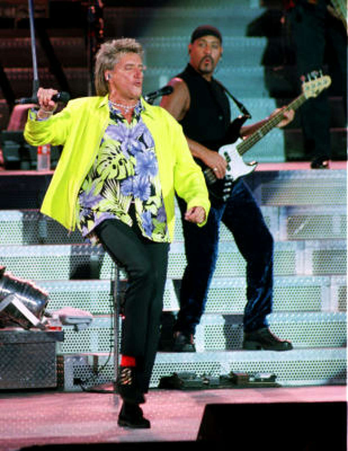 Rod Stewart getting down in a neon yellow blazer at the Cynthia Woods Mitchell Pavilion in 1998.