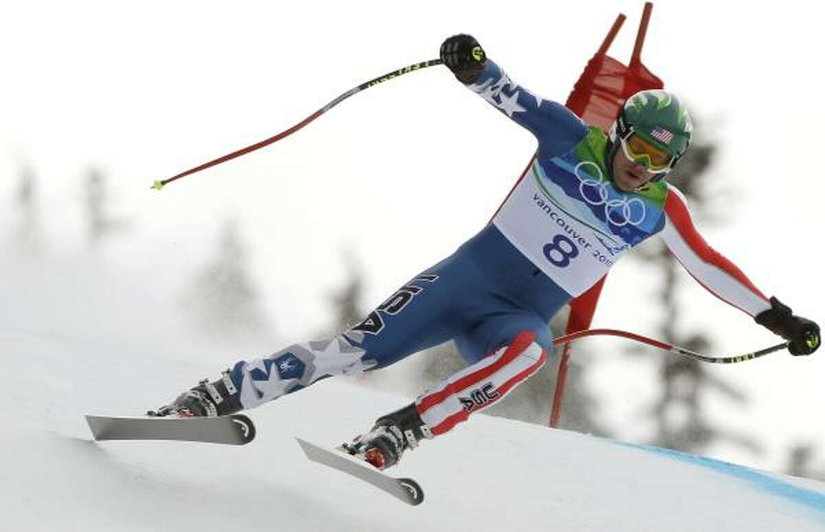 Bode Miller speeds down the men's downhill course on Feb. 15. Miller won the bronze medal.