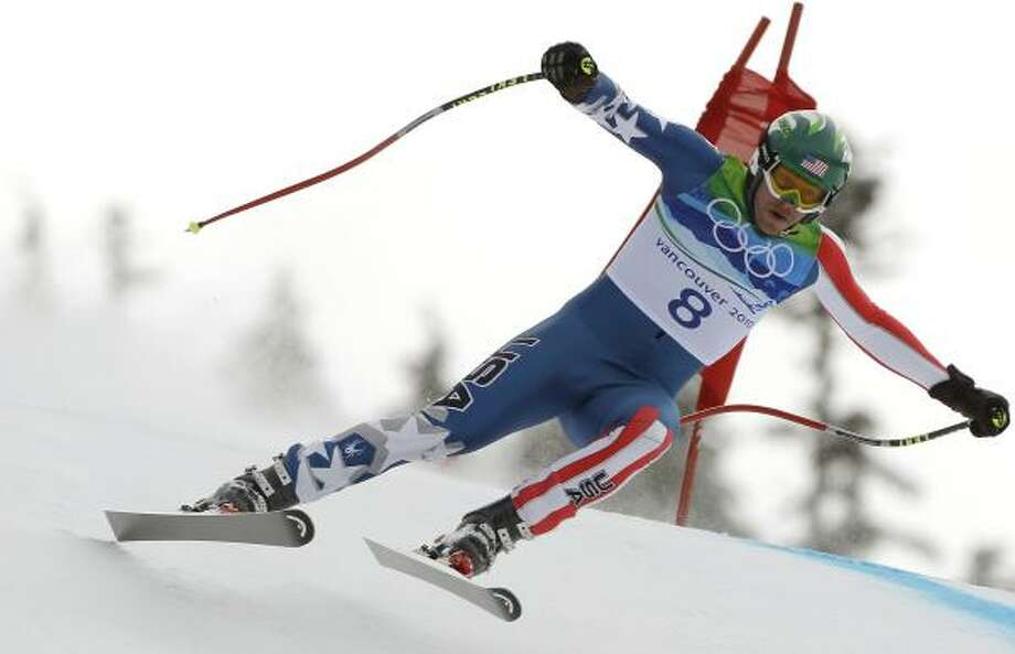 Bode Miller speeds down the men's downhill course on Feb. 15. Miller won the bronze medal. Photo: Charlie Krupa, AP