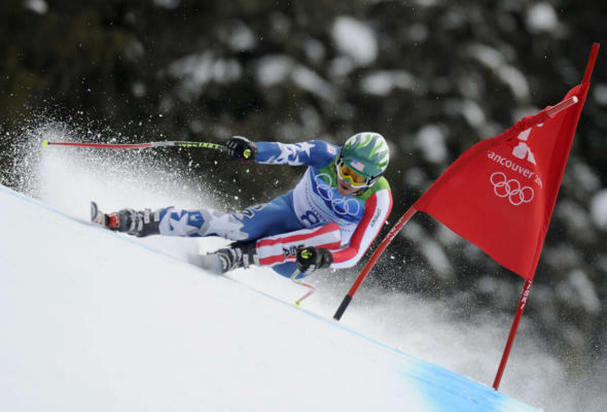 Bode Miller clears a gate during his run.