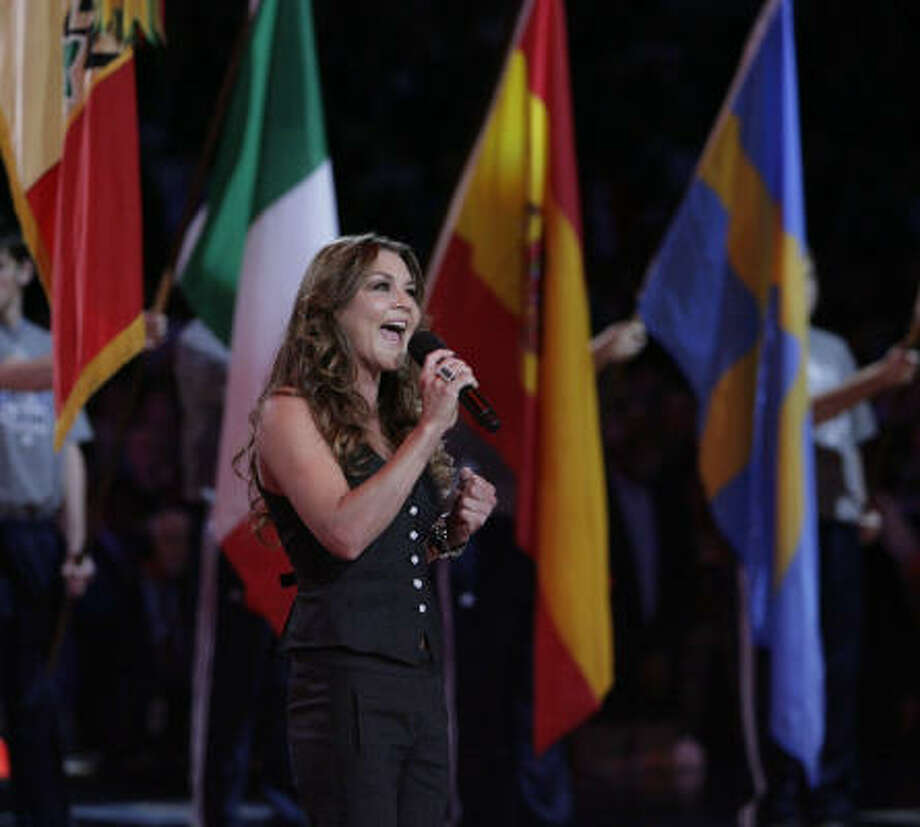 Country music singer Gretchen Wilson sings the national anthem before the All-Star  Game at Cowboys Stadium in Arlington on Sunday. Photo: Billy Smith II, Chronicle