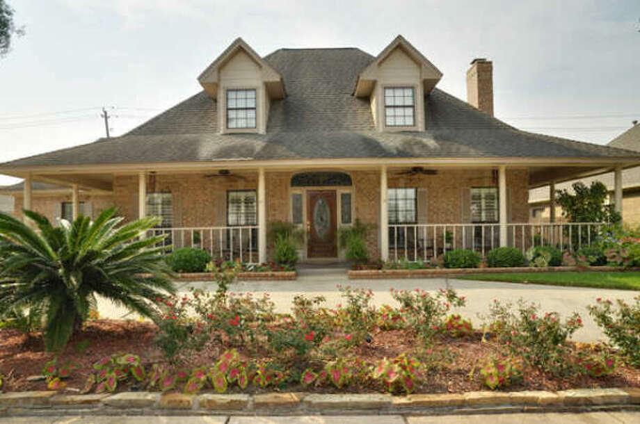This property has a wrap-around porch and circular drive. Photo: John Daugherty Realtors