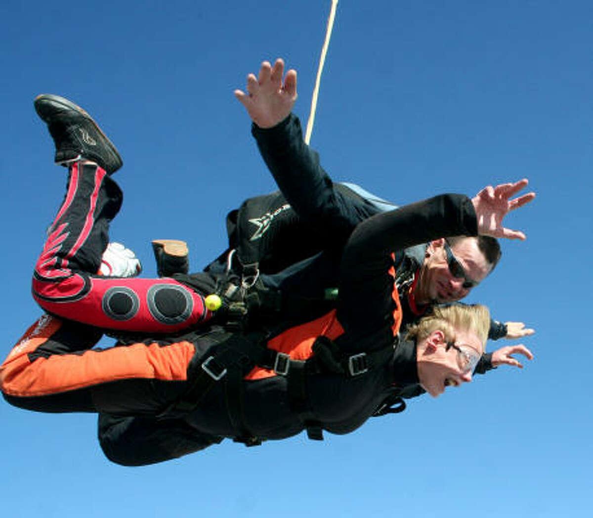 Sister Jane Meyer, 71, skydives with her instructor Phillip Schmit.