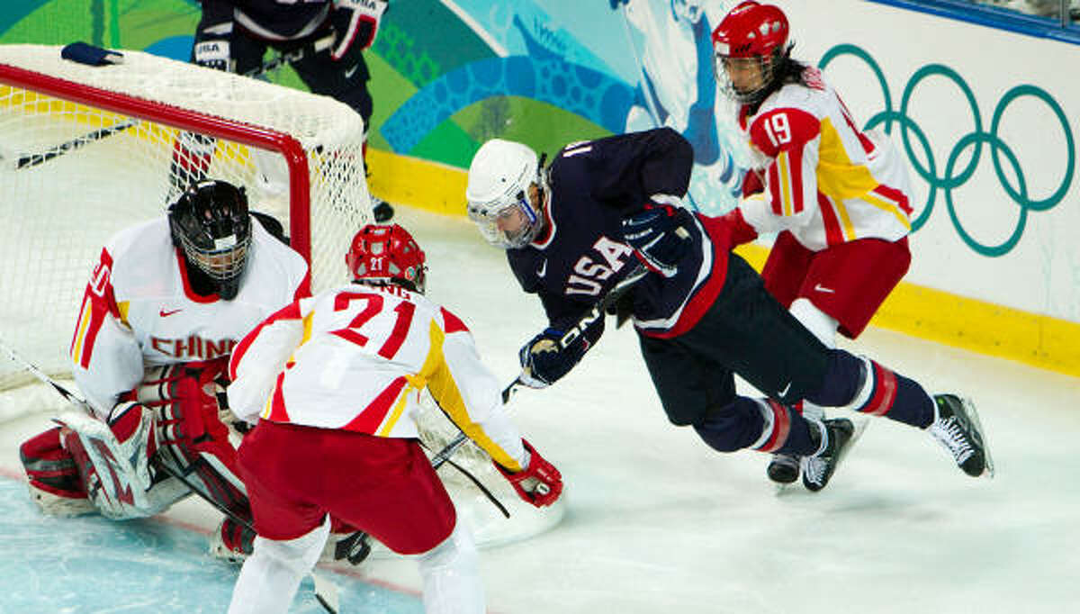U.S. forward Gigi Marvin, 19, is upended in front of China goalie Yao Shi.
