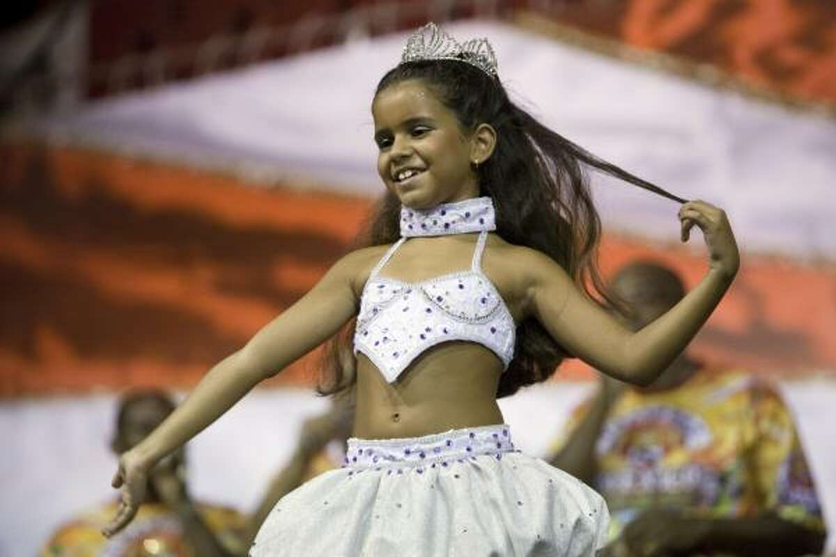 Julia Lira, 7, performs during a rehearsal of the Viradouro samba school in Rio de Janeiro, Wednesday, Feb.3, 2010. The tiny dancer will be at the helm of the Viradouro samba school's parade -- which has been known for attracting attention in the past for an ill-fated Holocaust-themed float and for having local superstar actresses like Juliana Paes and Luma de Oliveira at the front of their shows. Read the story | More world news | Chron.com