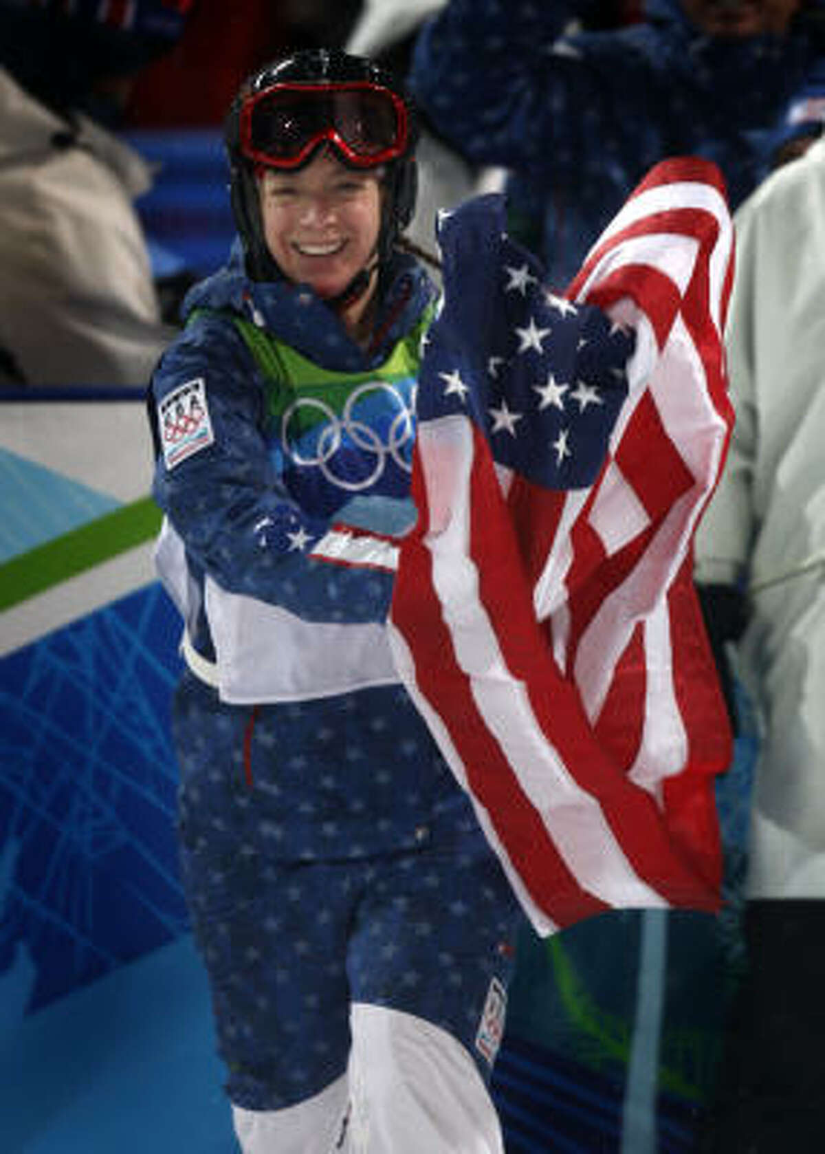 Hannah Kearney waves the American flag after capturing the gold medal in the women's mogul competition Saturday in West Vancouver, B.C.