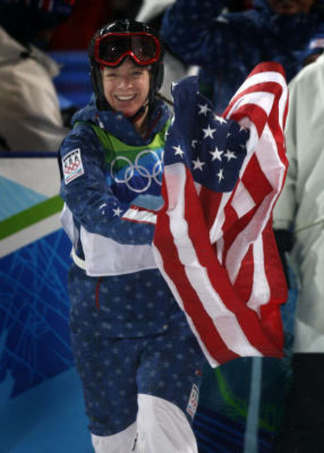 Hannah Kearney waves the American flag after capturing the gold medal in the women's mogul competition Saturday in West Vancouver, B.C. Photo: Paul Chinn, Chronicle Olympic Bureau