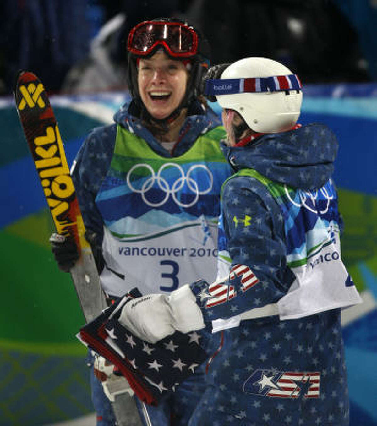 U.S. teammates Hannah Kearney, left, and Shannon Bahrke congratulate each other after finishing first and third, respectively, in the moguls competition.