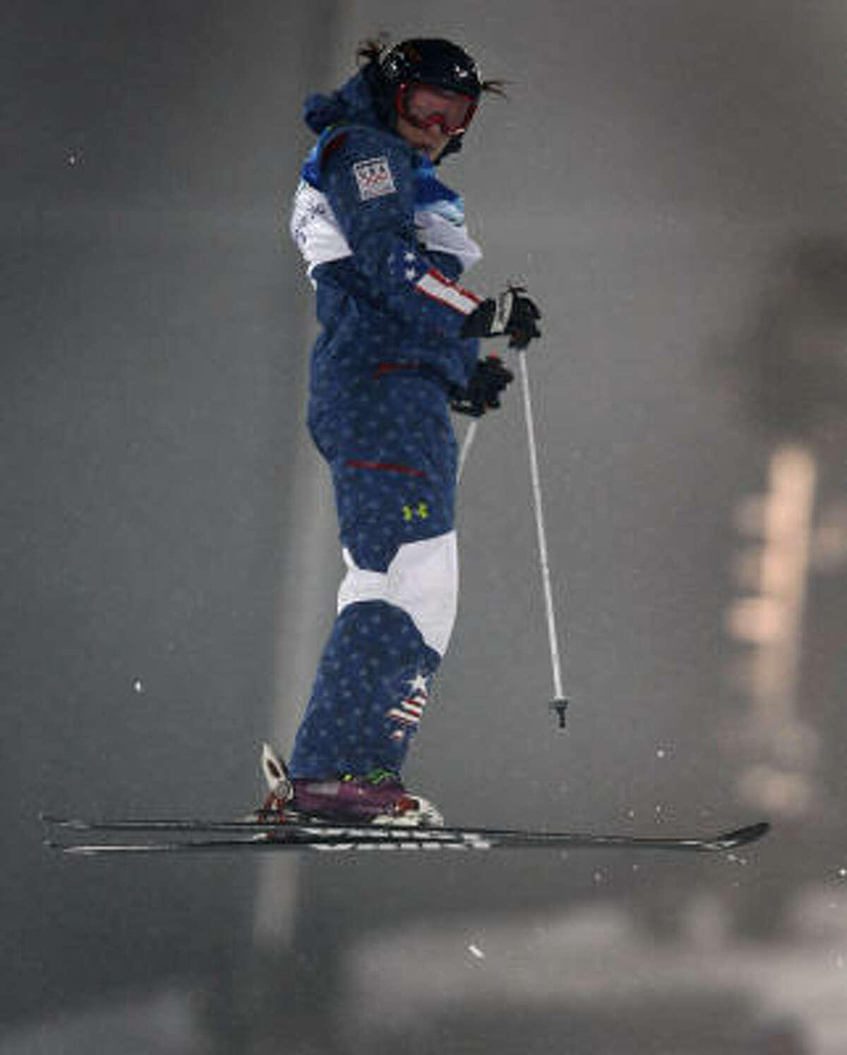Hannah Kearney completes a helicopter spin on her gold-medal run in the women's moguls competition.