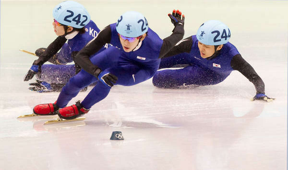 A crash by Korea's Ho-Suk Lee (242) and Si-Bak Sung (244) opened the way for American Apolo Anton Ohno to finish second to winnner Jun-Su Lee in the mens' 1500-meter finals in short track speed skating Saturday at the Pacific Coliseum in Vancouver. Ohno won his sixth Olympic medal after finishing in 2 minutes, 17.976 seconds.