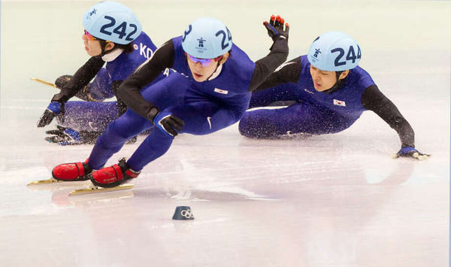 A crash by Korea's Ho-Suk Lee (242) and Si-Bak Sung (244) opened the way for American Apolo Anton Ohno to finish second to winnner Jun-Su Lee in the mens' 1500-meter finals in short track speed skating Saturday at the Pacific Coliseum in Vancouver. Ohno won his sixth Olympic medal after finishing in 2 minutes, 17.976 seconds. Photo: Smiley N. Pool, Chronicle Olympic Bureau