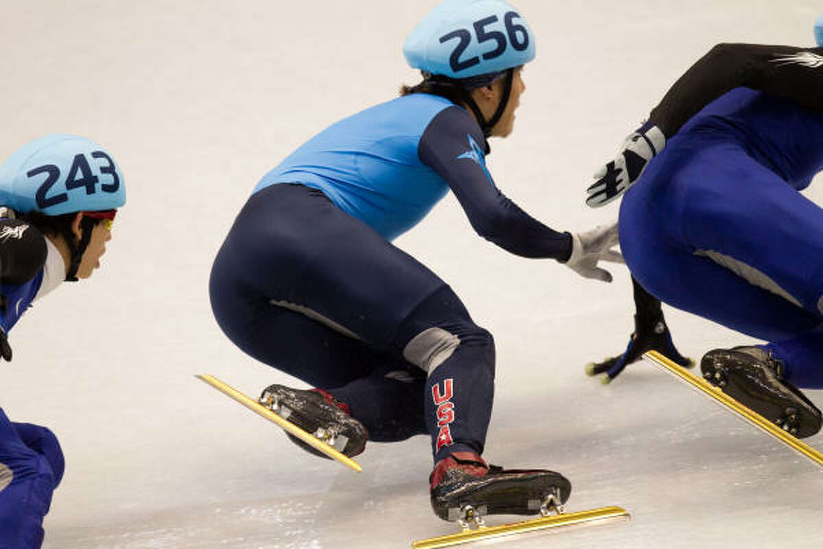 Apolo Anton Ohno (256) jostles for position in a turn on his way to winning the silver medal.