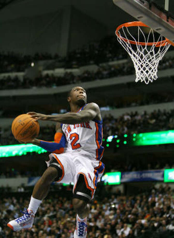New York Knicks guard Nate Robinson slams home a dunk during Saturday's slam dunk contest at the American Airlines Center in Dallas. He went on to win the event. Photo: Billy Smith II, Chronicle