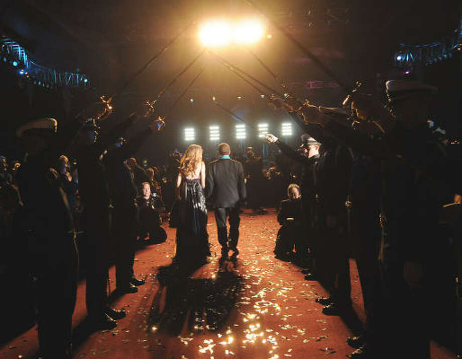Hosts Tilman and Paige Fertitta enter the ballroom at the San Luis Salute benefiting the University of Texas Medical Branch's Hospital and Surgical Care Tower. Photo: Dave Rossman, For The Chronicle