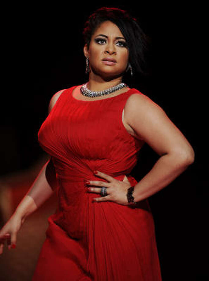 Raven-Symone models a Tadashi Shoji from The Heart Truth Red Dress collection during Fashion Week in New York. See what other celebs walked the runway. Read more about the event here. Photo: Stephen Chernin, AP