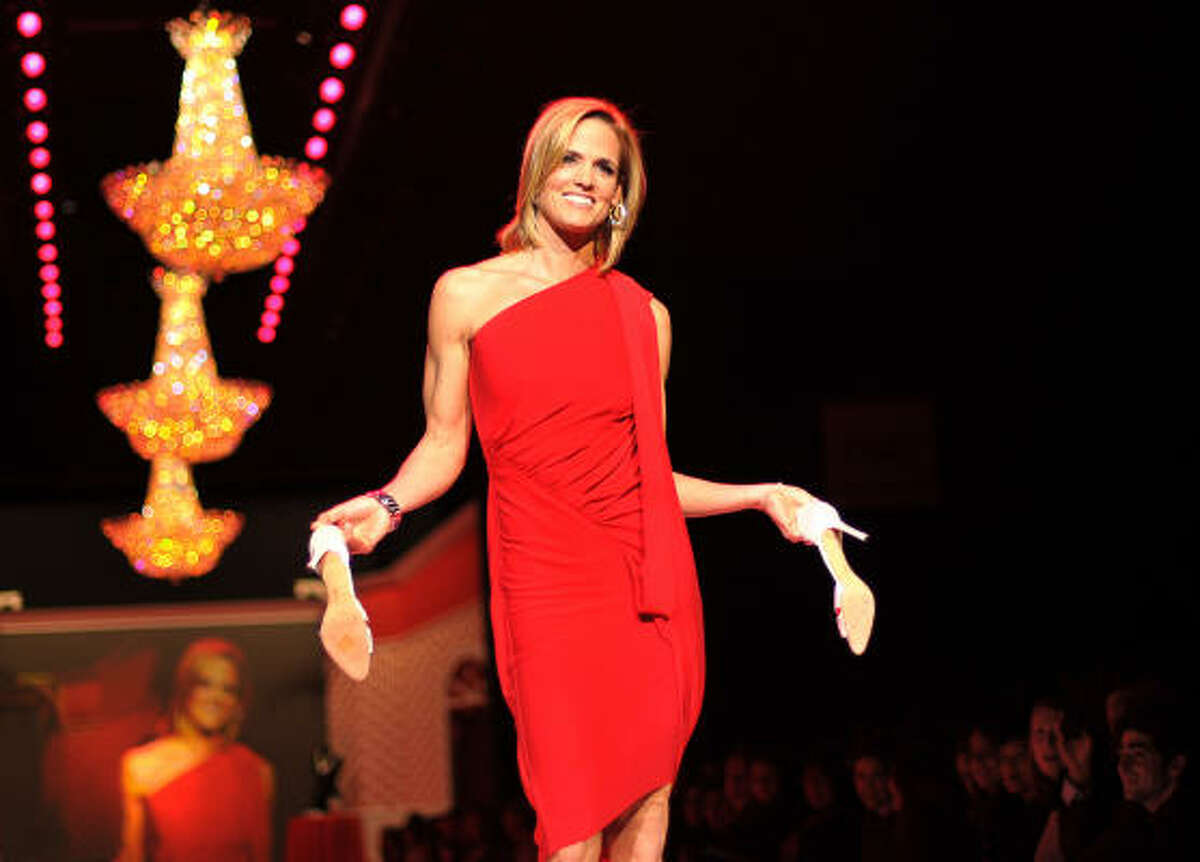 Dara Torres models a Rachel Roy design from The Heart Truth Red Dress collection during Fashion Week in New York. See what other celebs walked the runway.