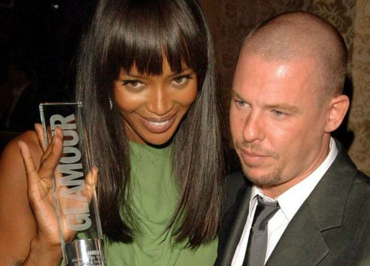 Alexander McQueen shown here with model Naomi Campbell in 2006. The British designer was found dead today. See which stars wore his designs and read more about him here.