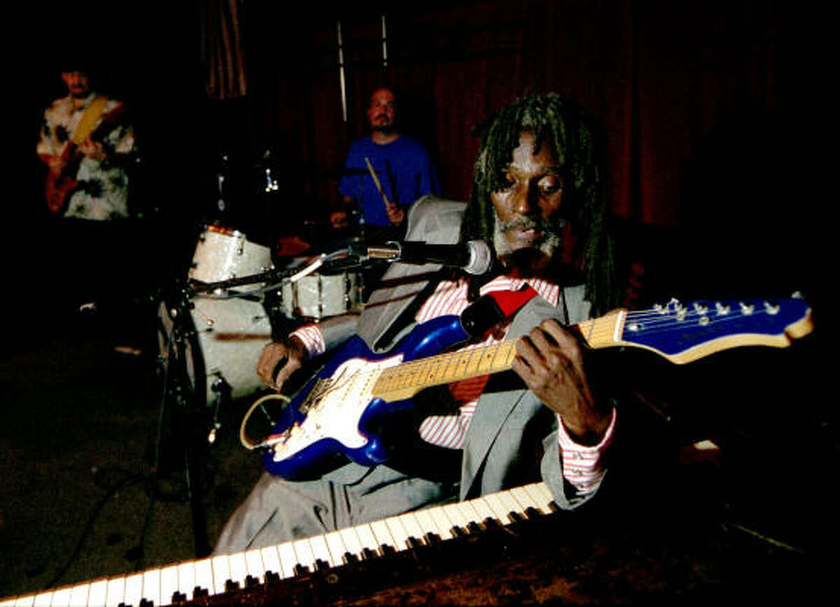 Little Joe Washington's style of playing blues involves his hands, feet, elbows and any other part he can use to strum a guitar or pound a piano.