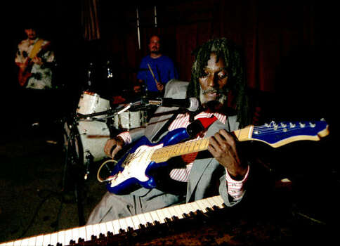 Little Joe Washington's style of playing blues involves his hands, feet, elbows and any other part he can use to strum a guitar or pound a piano. Photo: Andrew Innerarity, Houston Chronicle
