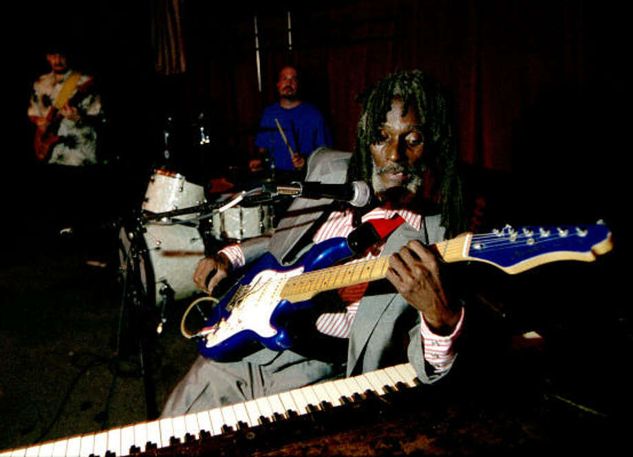 Little Joe Washington'sstyle of playing blues involves his hands, feet, elbows and any other part he can use to strum a guitar or pound a piano. Photo: Andrew Innerarity, Houston Chronicle