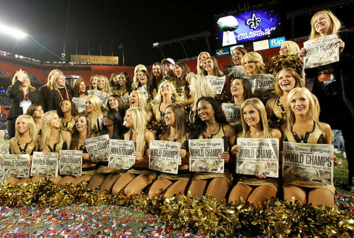 New Orleans Saints cheerleaders hold papers celebrating the Saints' win over the Indianapolis Colts in Super Bowl XLIV.
