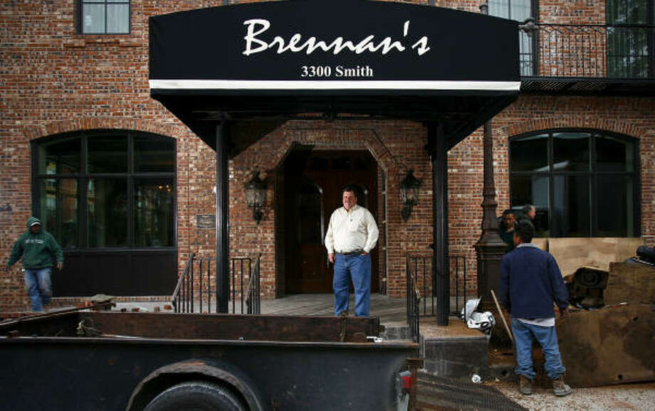 Alex Brennan-Martin, President of Brennan's of Houston, stands outside the Brennan's restaurant  which was nearly destroyed in September 2009 when a transformer fire caused by the whipping winds of Hurricane Ike engulfed the historic building in flames.  The restaurant is slated to reopen this coming Tuesday. Photo: Michael Paulsen, Chronicle