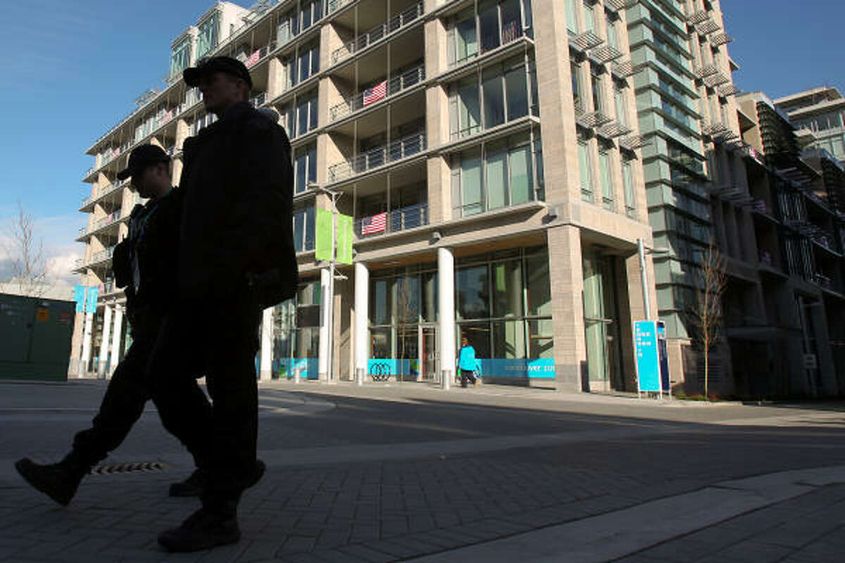 Two security officers patrol a street at the athletes village in advance of the 2010 Winter Olympic Games in Vancouver.