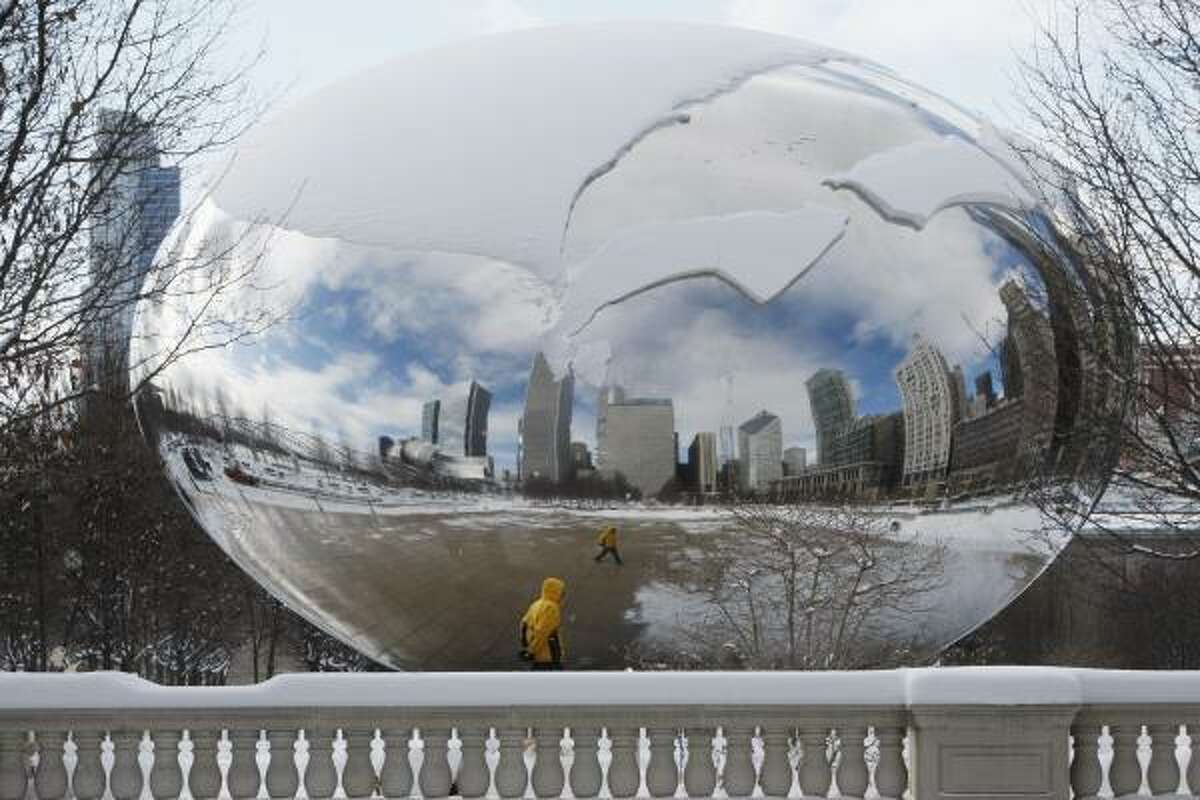 Blocks of snow slowly slide down Anish Kapoor's sculpture called