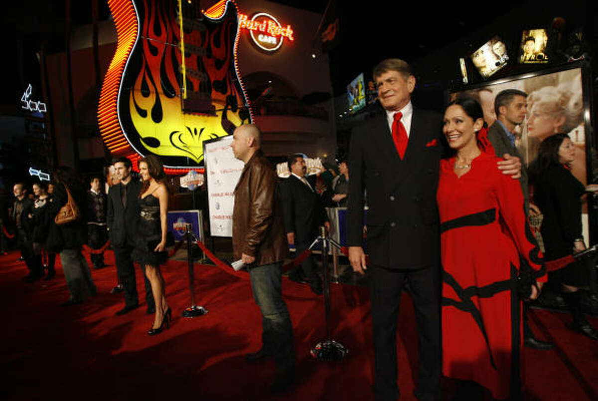 Charlie and Barbara Wilson join other celebrities on the red carpet before the movie 'Charlie Wilson's War.'