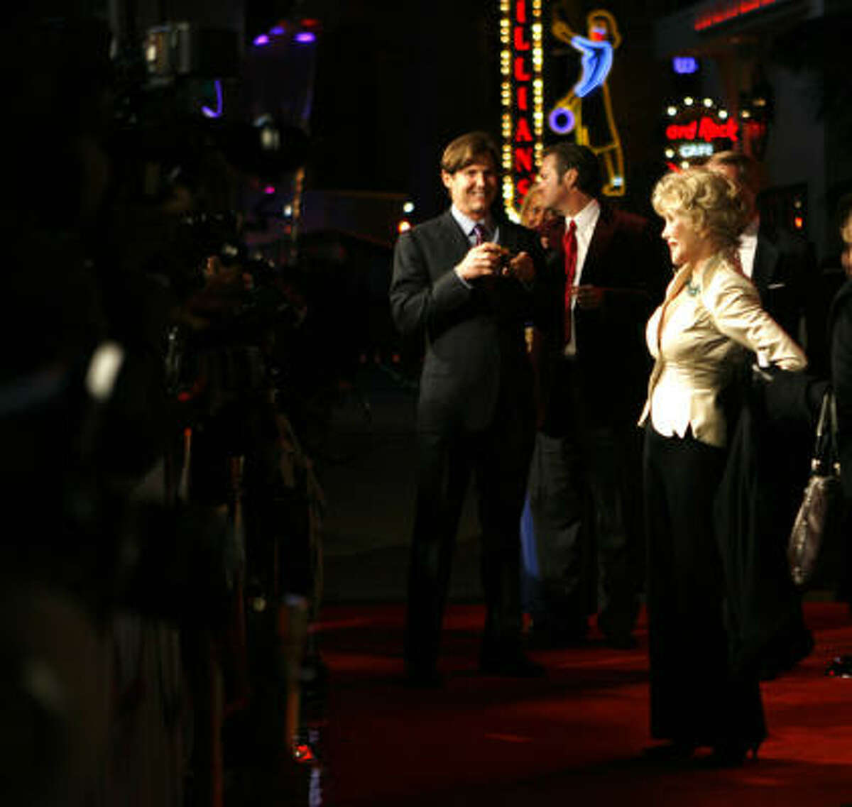 Joanne Herring stops for photographers along the red carpet during the premiere.