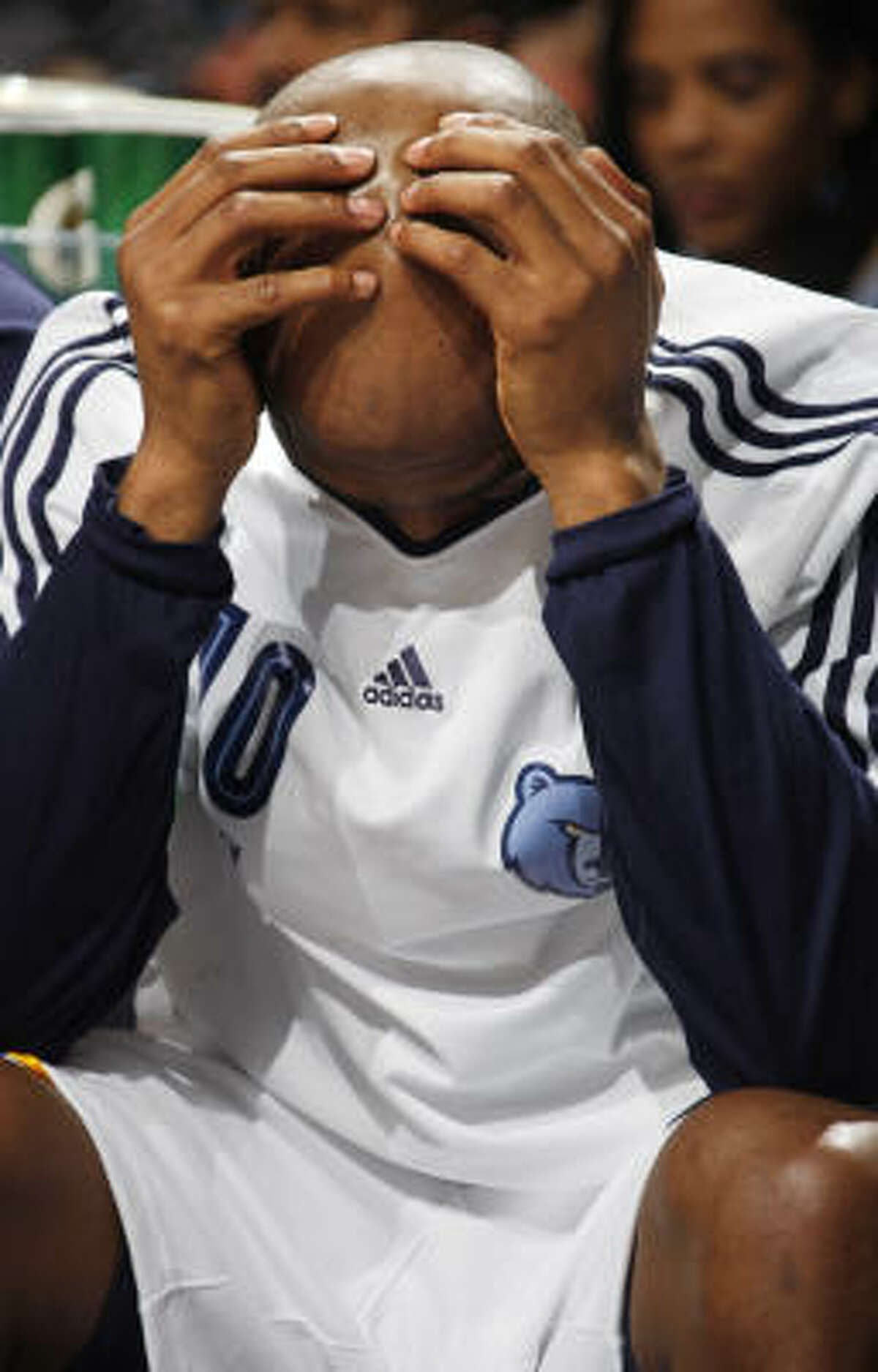 Grizzlies guard Jamaal Tinsley buries his face in his shirt during the loss. Tinsley missed all five of his shots in his 14:45 on the court.